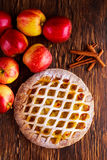 Home baked Lattice apple pie on wooden table Royalty Free Stock Images