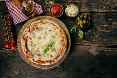 Home baked margarita pizza with ingredients Stock Photo