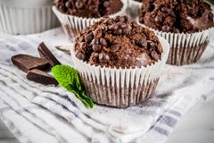 Mint and chocolate muffins. Home baked mint and chocolate muffins with mint tea, white marble background copy space stock images