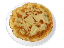 Home baked pancake. Thin home baked pancake on the plate Royalty Free Stock Photography