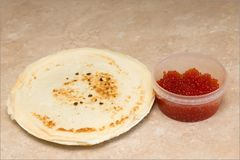 Home baked pancakes. Delicious home made pancakes with red caviar royalty free stock image