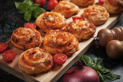Home baked pizza rolls stock photography