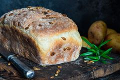 Home baked potato bread. On rustic wooden table stock photography