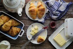 Home-baked puff pastry butter croissants with marmalade in rusti. Concept of afternoon snack. Concept of afternoon tea. Home-baked puff pastry butter croissants Royalty Free Stock Photos