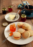 Home-baked scones tea with jam and butter Stock Photo