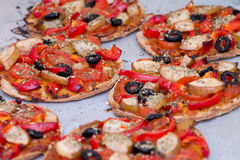 Home baked vegan mini pizza on parchment paper royalty free stock photography