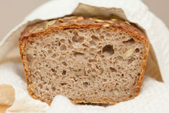 Home baked whole grain loaf. Soure daught bread baked at home Royalty Free Stock Photography