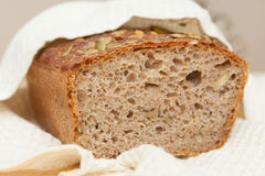 Home baked whole grain loaf. Soure daught bread baked at home Stock Images