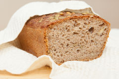 Home baked whole grain loaf. Soure daught bread baked at home Royalty Free Stock Photo