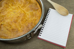 Home baking with recipe book Stock Photos