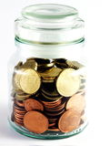 Home Banking - Jar with Coins. A jar with some small Euro coins inside. Step two of home banking or personal finances management stock image