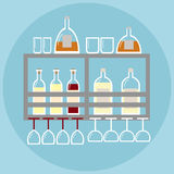 Home bar on the shelf in modern style with stemware and bottles of alcohol. Royalty Free Stock Images