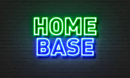 Home base neon sign on brick wall background. Stock Photos