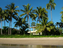 Home on the Beach. View of a beautiful private home in a tropical setting right on the beach Royalty Free Stock Photo