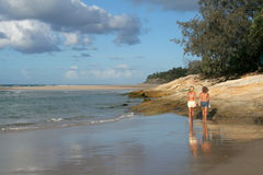 Home Beach. Two women walking on Home Beach at Point Lookout, North Stradbroke Island in Australia stock photos