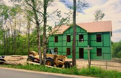 Home Being Built carpentry construction. Two-story home in the process of going up, view from the outside, framework, roof, outer insulation, construction Royalty Free Stock Photo