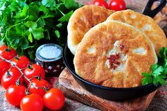 Home belyashi open pies, fried in olive oil with lamb and onions Stock Images