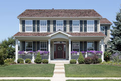 Home with blue shutters and front porch. Suburban home with blue shutters and front porch Royalty Free Stock Photos