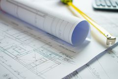 Home blueprint on the architect`s desk stock photography