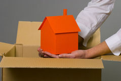 Home from the box. Home model on woman's hand royalty free stock image