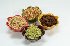 Home brew ingredients. Home brew beer ingredients with varying colors of malt barley grain to illustrate different grains in beer recipes Stock Image