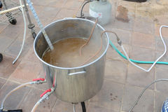 Home Brewing beer kettle. Insertion chiller inserted into boiling wort and pump starting whirlpool Stock Photography