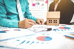 Signing of paper work home buying with broker and buyer. stock images