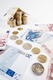 Home build with euro bank notes with a path made of coins - busi Royalty Free Stock Photo