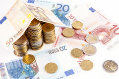 Home build with euro bank notes with a path made of coins - business concept royalty free stock images