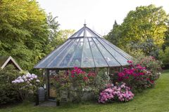 Home build greenhouse in a garden stock images
