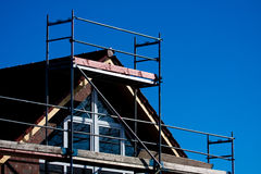 Home Building. Scaffolding at your own house Royalty Free Stock Image