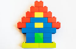 Home building blocks with plastic toy Royalty Free Stock Photo