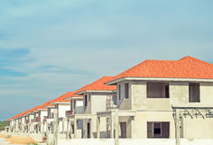 Home Building Construction. Exterior of town home building under construction with sky background royalty free stock photo