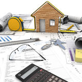 Home building process. A house under construction on top of a table with mortgage application form, calculator, blueprints, etc stock images