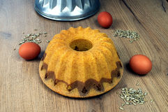 Home bundt cake with a form and egg Stock Photo