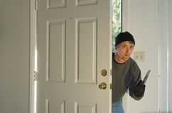 Home burglary with a knife Stock Image