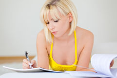 Home business. Woman at home doing paperwork and controling finance papers stock images