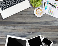 Home business desk with communication device. On wood Stock Images