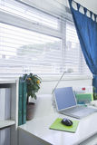Home and Business office interior set up. With a laptop on a white desk Royalty Free Stock Photo