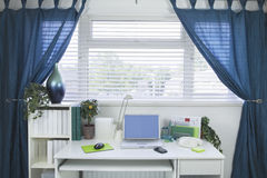 Home and Business office interior set up. With a mobile phone and laptop on a white desk Stock Photos