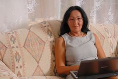 Home Business Woman 14. Business woman at home working on computer royalty free stock photo