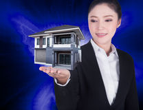 Home in business woman hand Royalty Free Stock Photo
