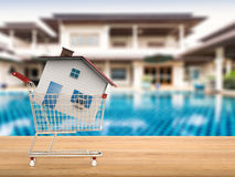 Home buyer concept. With mock up house in shopping cart royalty free stock images