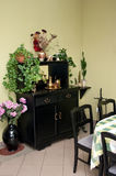Home cabinet furniture. Home cabinet with decorative plants, possibly dining room furniture Royalty Free Stock Photo