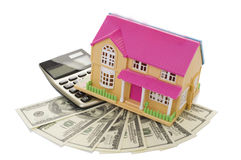 Home on a calculator and dollars Stock Photography