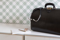 Home call, doctor's bag with stethoscope Stock Image
