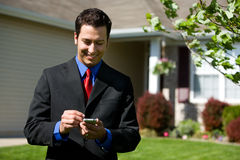 Home: Calling the Office About House Stock Images