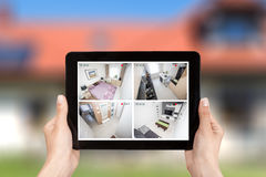 Home camera cctv monitoring monitor system alarm smart house vid. Home camera cctv monitoring monitor smart house video system hand exterior closeup concept royalty free stock images