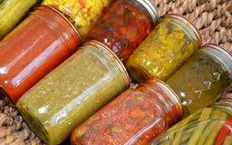 Home Canned Food Variety. Canned food items arranged in a basket stock photography