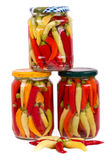 Home Canned Jars of Peppers on white background Stock Image